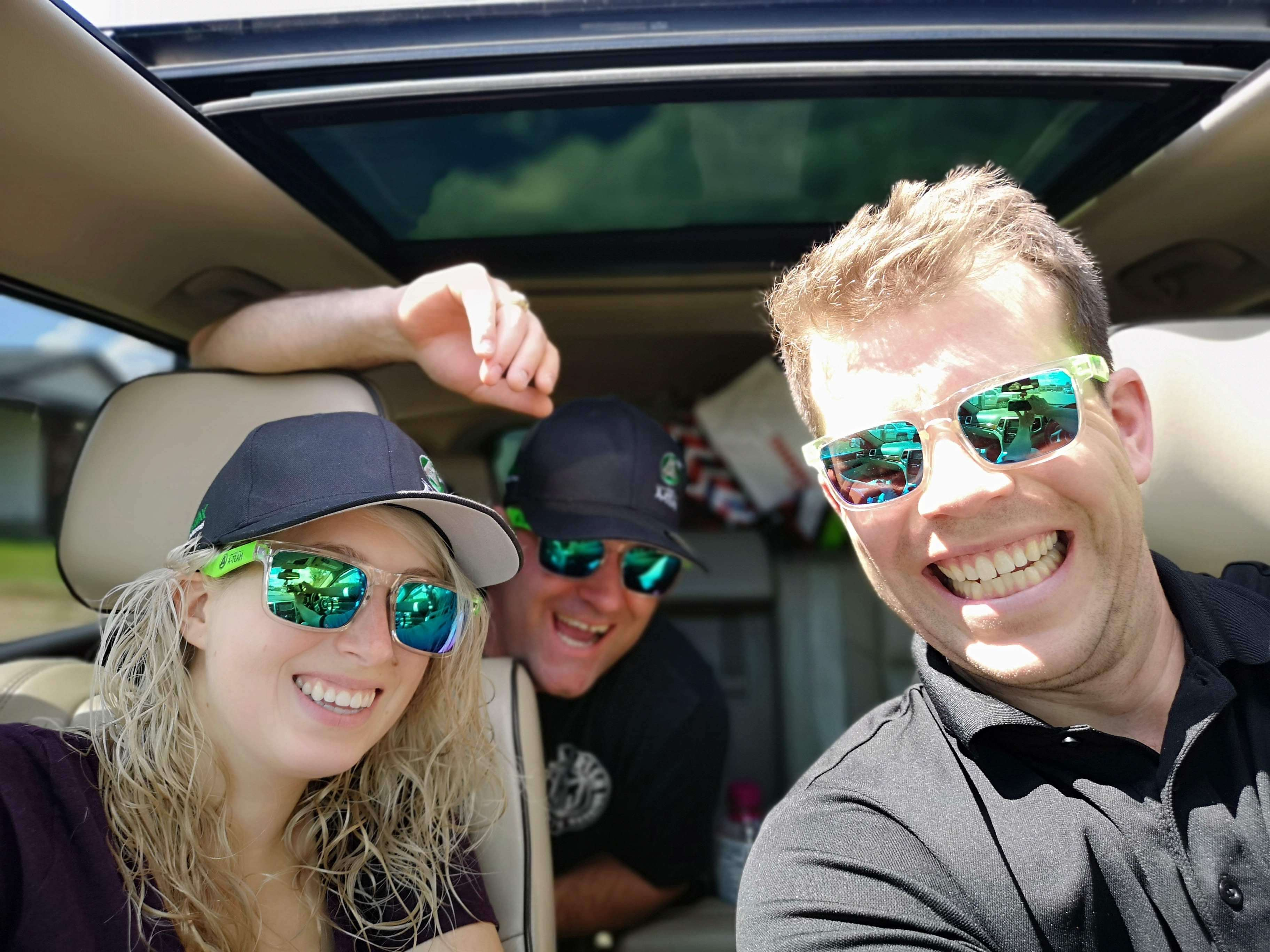 Tom and a couple in a car smiling